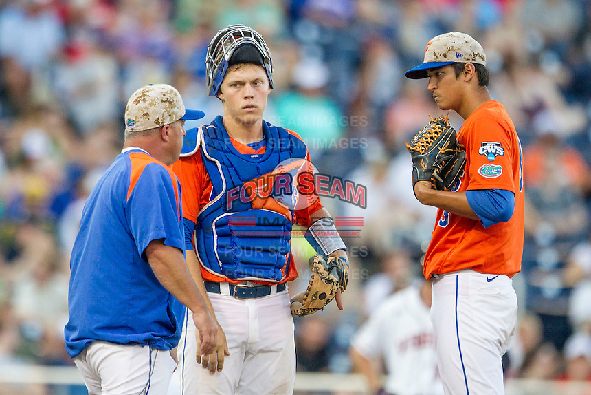 Florida Gators catcher JJ Schwarz (22) on the mound with Head Coach Kevin O'Sullivan and starting pitcher Dane Dunning (3) against the Virginia Cavaliers in Game 13 of the NCAA College World Series on June 20, 2015 at TD Ameritrade Park in Omaha, Nebraska. The Cavaliers beat the Gators 5-4. (Andrew Woolley/Four Seam Images)