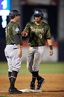 Tampa Tarpons Tyler Hill (9) fist bumps third base coach Kevin Mahoney (37) during a Florida State League game against the Daytona Tortugas on May 18, 2019 at George M. Steinbrenner Field in Tampa, Florida.  Daytona defeated Tampa 7-6.  (Mike Janes/Four Seam Images)