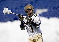 Andy Warner (1) of Navy passes the ball off at the Navy-Marine Corp Memorial Stadium in Annapolis, Maryland.   Loyola defeated Navy, 8-7, in overtime.