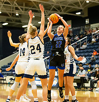 Kate Miller (22) of Rogers up with the shot as Madison Phillips (24) of Bentonville West goes up for the block at Wolverine Arena, Centerton,  AR, Tuesday, January 12, 2021 / Special to NWA Democrat-Gazette/ David Beach