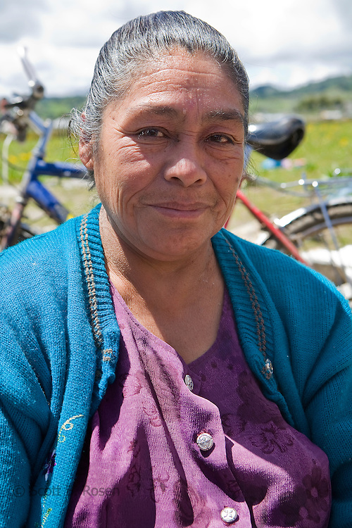 Guatemalan woman poses outside a church in San Nicolas, Western Highlands, Guatemala