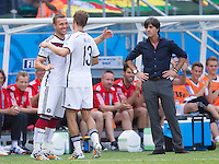 Thomas Muller hugs Lukas Podolski as he is substituted off by Germany manager Joachim Low