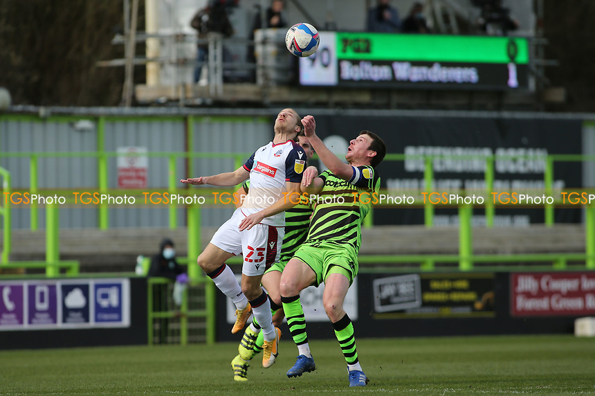 Forest Green Rovers's Chris Stokes and Bolton Wanderers's Lloyd Isgrove during Forest Green Rovers vs Bolton Wanderers, Sky Bet EFL League 2 Football at The New Lawn on 27th March 2021