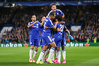 Willian of Chelsea (front left - 22) celebrates scoring the opening goal against Maccabi Tel Aviv during the UEFA Champions League match between Chelsea and Maccabi Tel Aviv at Stamford Bridge, London, England on 16 September 2015. Photo by David Horn.