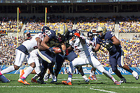 PItt running back Quadree Ollison (37) scores on a four yard touchdown run. The Pitt Panthers football team defeated the Virginia Cavaliers 26-19 on Saturday October 10, 2015 at Heinz Field, Pittsburgh, Pennsylvania.