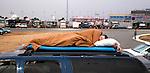 C.J. Thompson, from Charlotte, North Carolina, sleeps on the roof of his vehicle at dawn prior to the NASCAR Sprint Cup Series Daytona 500 auto race at Daytona International Speedway in Daytona Beach, Florida February 24, 2013.<br /> (CREDIT: Mark Wallheiser for UPI Newsphotos) ©2013 Mark Wallheiser