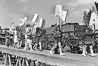 1967 FILE PHOTO - ARCHIVES -<br /> <br /> A slight mix-up in the letters spelling out Canada brought good-natured laughter from spectators watching these children parading outside the Canadian pavilion at Expo yesterday. It was a cool and windy day; making the letters difficult to hold. In the left background is the French pavilion; at right Quebec's.<br /> <br /> 1967<br /> <br /> PHOTO : Boris Spremo - Toronto Star Archives - AQP