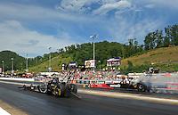 Jun. 19, 2011; Bristol, TN, USA: NHRA top fuel dragster driver Larry Dixon (left) alongside Rod Fuller during eliminations at the Thunder Valley Nationals at Bristol Dragway. Mandatory Credit: Mark J. Rebilas-