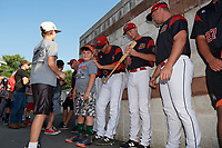 Batavia Muckdogs players Colton Hock (13), Tyler Frohwirth (56), and Ryan Lillie (35) sign autographs before a game against the Mahoning Valley Scrappers on August 30, 2017 at Dwyer Stadium in Batavia, New York.  Batavia defeated Mahoning Valley 5-1.  (Mike Janes/Four Seam Images)
