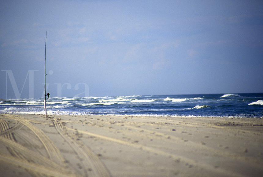 Fishing Pole Fishing on Ocean shore Fishing on beach. Solo Fishing pole.