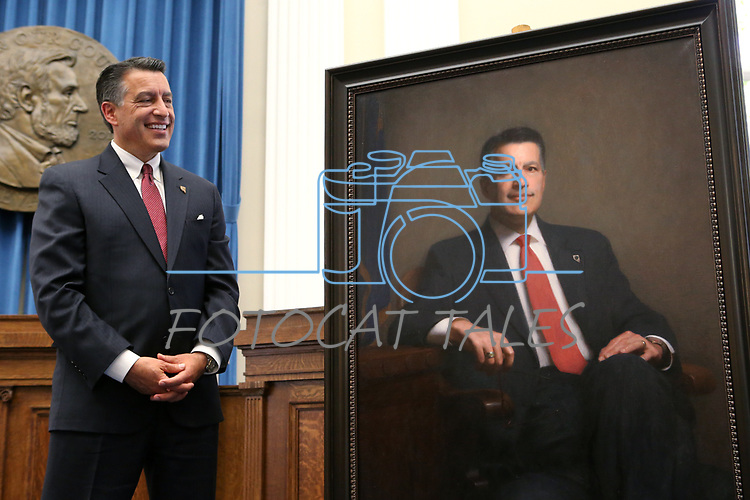 Gov. Brian Sandoval checks out his official portrait during a ceremony at the Capitol in Carson City, Nev., on Thursday, Oct. 25, 2018. <br /> Photo by Cathleen Allison/Nevada Momentum
