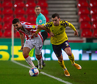 21st November 2020; Bet365 Stadium, Stoke, Staffordshire, England; English Football League Championship Football, Stoke City versus Huddersfield Town; Tommy Smith of Stoke City and Harry Toffolo of Huddersfield Town chase a loose ball