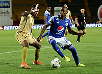 BOGOTA-COLOMBIA, 11-10-2020: Emerson Rodriguez de Millonarios y Geovan Montes de Rionegro Aguilas Doradas disputan el balon, durante partido entre Millonarios y Rionegro Aguilas Doradas de la fecha 13 por la Liga BetPlay DIMAYOR 2020 jugado en el estadio Nemesio Camacho El Campin de la ciudad de Bogota. / Emerson Rodriguez of Millonarios and Geovan Montes of Rionegro Aguilas Doradas figth for the ball, during a match between Millonarios and Rionegro Aguilas Doradas of the 13th date for the BetPlay DIMAYOR League 2020 played at the Nemesio Camacho El Campin Stadium in Bogota city. / Photo: VizzorImage / Luis Ramirez / Staff.