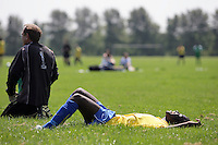 A Clapton Rangers FC player lies down in the grass during a Hackney & Leyton League match at Hackney Marshes - 11/05/08 - MANDATORY CREDIT: Gavin Ellis/TGSPHOTO - Self billing applies where appropriate - Tel: 0845 094 6026