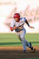 Luke Tendler #17 of the Spokane Indians runs the bases during a game against the Salem-Keizer Volcanoes at Volcanoes Stadium on July 26, 2014 in Keizer, Oregon. Spokane defeated Salem Keizer, 4-1. (Larry Goren/Four Seam Images)