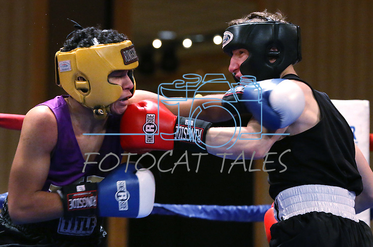 Army's Jordan Isham, right, defeats University of Washington's Ronnie Epting during a National Collegiate Boxing Association bout at the El Dorado Casino in Reno, Nev. on Friday, Feb. 5, 2016. <br /> Photo by Cathleen Allison
