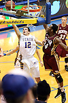 BROOKINGS, SD - FEBRUARY 27:  Brayden Carlson #12 from South Dakota State takes the ball to the basket past Chris Udofia #34 from Denver University in the first half of their game Thursday night at Frost Arena in Brookings. (Photo by Dave Eggen/Inertia)