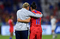 DECINES-CHARPIEU, FRANCE - JULY 02: Jill Ellis, Ali Krieger #11 celebrate together during a 2019 FIFA Women's World Cup France Semi-Final match between England and the United States at Groupama Stadium on July 02, 2019 in Decines-Charpieu, France.