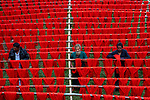 Thousands of red threads drying by Azim Khan Ronnie