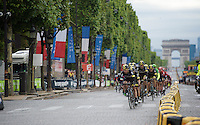 Team SKY pilots the peloton over the Champs Elysées for the first 2 local laps in a specifically adapted teamkit (very much adapted to the Parisian road barriers apparently...)<br /> <br /> stage 21: Sèvres - Champs Elysées (109km)<br /> 2015 Tour de France