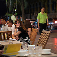 Dinner at night in the streets of Saigon or in Vietnamese Ho Chi Minh City where old and new architecture mix in harmony. The bustling Metropolis of South Vietnam.