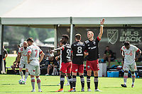 LAKE BUENA VISTA, FL - JULY 13: Oniel Fisher #91 of DC United, Ulises Segura #8 of DC United and Frederic Brillant #13 of DC United wait for the free kick during a game between D.C. United and Toronto FC at Wide World of Sports on July 13, 2020 in Lake Buena Vista, Florida.