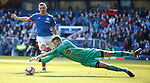 Keeper Grant Hay dives at the feet of Lee McCulloch