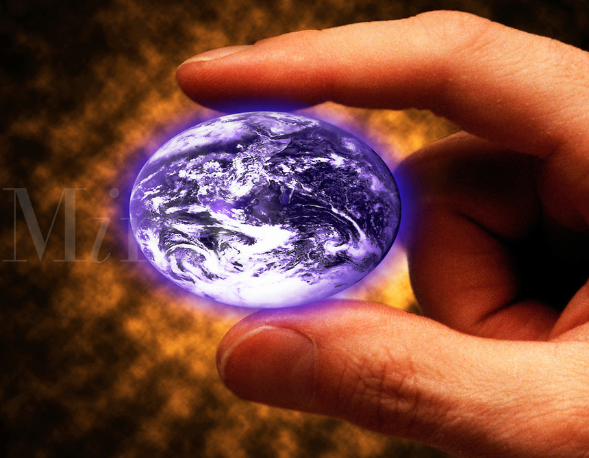 fingers squeezing earth in to egg shape.