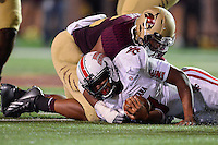 Louisiana Lafayette quarterback Terrance Broadway (8) is brought down by Texas State defensive end Michael Odiari (55) during first half of an NCAA football game, Tuesday, October 14, 2014 in San Marcos, Tex. Louisiana Lafayette leads 21-3 at the halftime. (Mo Khursheed/TFV Media via AP Images)