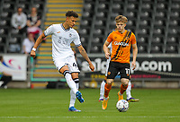 11th September 2021; Swansea.com Stadium, Swansea, Wales; EFL Championship football, Swansea versus Hull City; Rhys Williams of Swansea City passes the ball while under pressure from Keane Lewis-Potter of Hull City