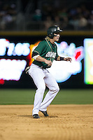 Brett Netzer (9) of the Charlotte 49ers takes his lead off of second base against the North Carolina State Wolfpack at BB&T Ballpark on March 31, 2015 in Charlotte, North Carolina.  The Wolfpack defeated the 49ers 10-6.  (Brian Westerholt/Four Seam Images)