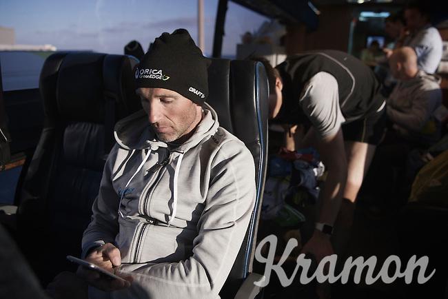 Michael Albasini (SUI/Orica-GreenEDGE) checking his messages post-race<br /> <br /> 107th Milano-Sanremo 2016