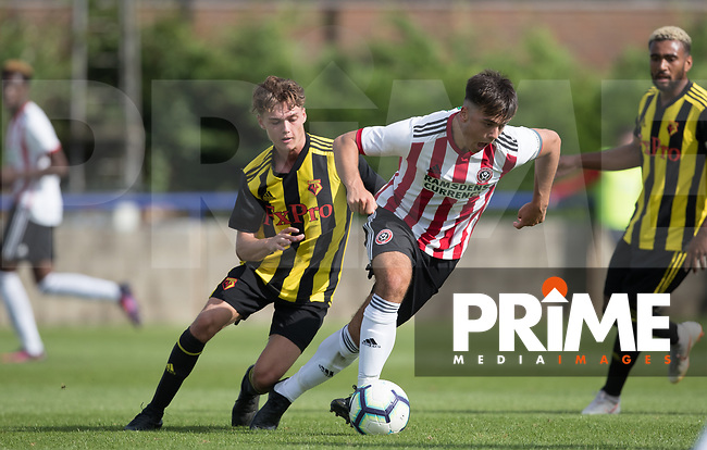Jordan Doherty of Sheffield United & Harry Forster of Watford during the Professonal Development League match between Watford U23 and Sheffield United U23 at The Maurice Rebak Stadium, Summers Lane, England on 17 August 2018. Photo by Andy Rowland.