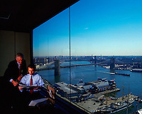 Executive businessmen review data from a posh corporate office, New York