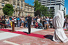 June 21, 2017; Children from the community unveil the new sculpture of the Rev. Theodore M. Hesburgh and the Rev. Martin Luther King in downtown South Bend.  (Photo by Barbara Johnston/University of Notre Dame)