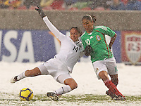 USA's Stephanie Cox (L) takes the ball from Mexico's Maribel Dominguez (R) at Rio Tinto Stadium March 31, 2010 in Salt Lake City, Utah. The USA women won the match over Mexico 1-0.