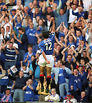 Claudio Reyna salutes the Rangers legions after scoring with a screaming freekick at Ibrox