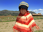 Peruvian girl in the high country of the Andes Mountains.