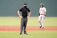 Umpire Adam Pierce works a game between the Hickory Crawdads and the Greenville Drive on Friday, June 18, 2021, at Fluor Field at the West End in Greenville, South Carolina. The catcher is Alan Marrero (1). (Tom Priddy/Four Seam Images)