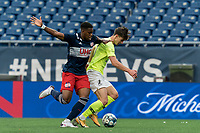 FOXBOROUGH, MA - MAY 12: Evan Conway #11 of Union Omaha on the attack as Francois Dulysse #60 of New England Revolution II defends during a game between Union Omaha and New England Revolution II at Gillette Stadium on May 12, 2021 in Foxborough, Massachusetts.