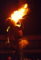 Man performing Polynesian fire eating, the entertainment at a luau, Sheraton Royal Hawaiian Hotel, Waikiki, Oahu