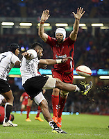 Pictured L-R: Nikola Matawalu of Fiji has his shot blocked by Luke Charteris of Wales. Saturday 15 November 2014<br />