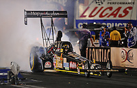 Oct. 31, 2008; Las Vegas, NV, USA: NHRA top fuel dragster driver Clay Millican does a burnout during qualifying for the Las Vegas Nationals at The Strip in Las Vegas. Mandatory Credit: Mark J. Rebilas-