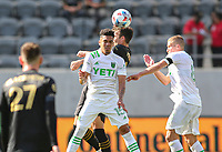 LOS ANGELES, CA - APRIL 17: Daniel Pereira #15 of Austin FC heads a ball during a game between Austin FC and Los Angeles FC at Banc of California Stadium on April 17, 2021 in Los Angeles, California.