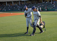 Charleston RiverDogs pitcher Jairo Heredia (18), left, puts his arm around catcher J.R Murphy (21) as they head to the bullpen for warmups prior to a game on May 27, 2010, at Fluor Field at the West End in Greenville, S.C. Photo by: Tom Priddy/Four Seam Images