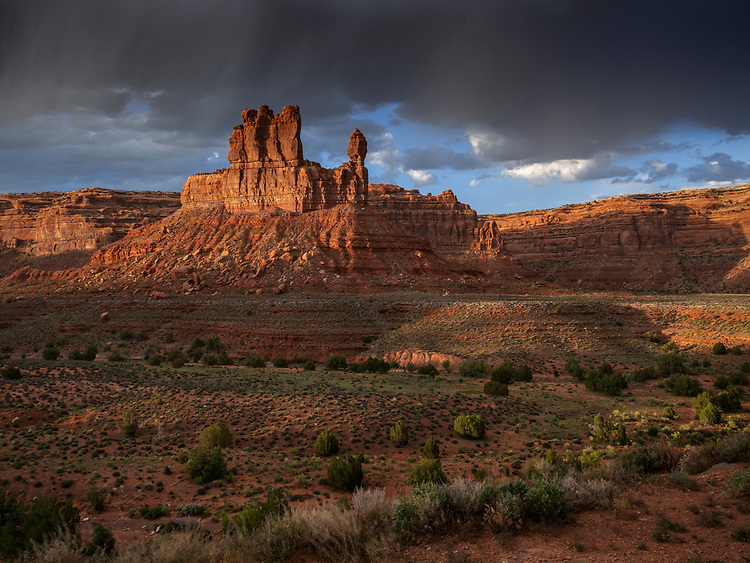 A storm brews over rock spires in the Valley of Gods in southern Utah, USA