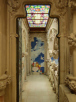 Every space, even a small corridor, has been designed to evoke idyllic views of the outside. Organic shapes and forms wind their way across the walls, floors, and ceilings through the use of carving, mosaic, and stained glass