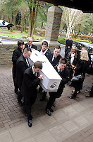 SWANSEA / Richard Youle<br /> Funeral of Swansea City fan Scott Bryant.<br /> The casket of Scott Bryant being carried into Morriston Crematorium.