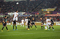 Pictured: Ashley Williams o Swansea (L) crosses the ball into the Everton box with a header. Tuesday 23 September 2014<br /> Re: Capital One Cup, Swansea City FC v Everton at the Liberty Stadium, south Wales, UK