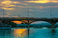 In downtown Austin, Texas, from March to October (typically), 1.5 million bats emerge nightly from narrow but deep crevices in the underside of the Ann W. Richards Congress Avenue Bridge. They usually start to emerge from the bridge around 20 minutes before sundown.